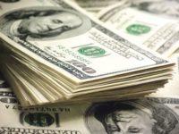 Dolarul atinge un nou minim al ultimelor şase luni